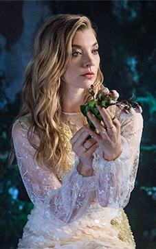 Natalie Dormer holding flowers.