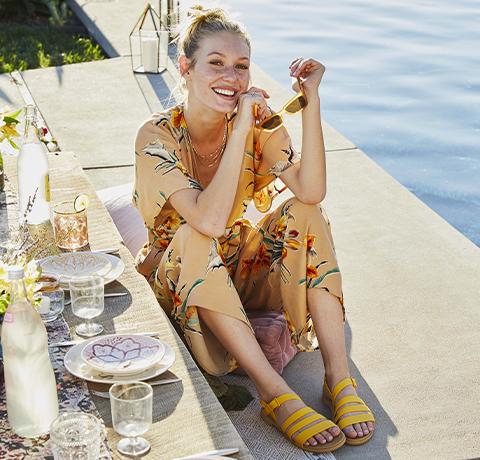 Models posing in assorted Crocs sandals.